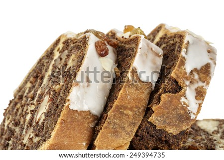 Poppy seed cake cut into portions is shown up close  - stock photo