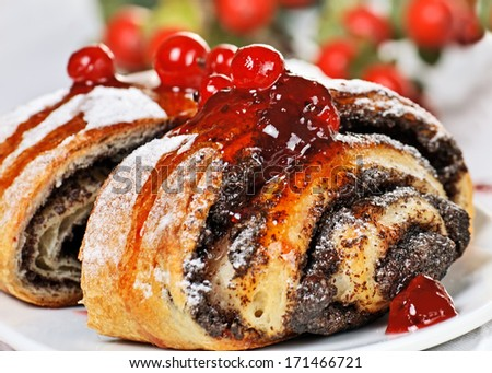 Poppy seed cake decorated berry close up. - stock photo