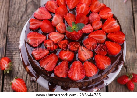 Poppy seed cake with strawberries and chocolate glaze,decorated with mint.selective focus - stock photo