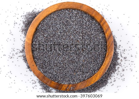 poppy seeds in a wooden bowl on a white background - stock photo