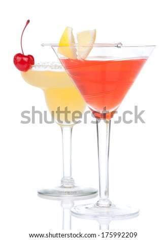 Popular alcoholic cocktails composition. Two cocktail drinks yellow margarita cherry and tropical Martini on a white background - stock photo
