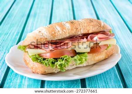 Popular ciabatta sandwich with cheese and meat,selective focus