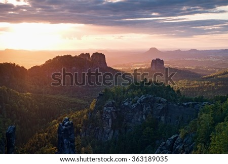 Popular climbers resort in Saxony national park, Germany. Sharp sandstone cliffs above deep valley. - stock photo