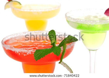 Popular Margaritas cocktails row. Strawberry, lime, mint and apple mexican beverages in margarita glasses  isolated on a white background