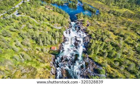 Popular norwegian waterfalls Likholefossen seen from air - stock photo
