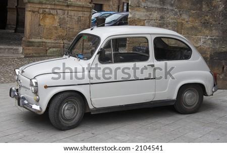 popular old small family spanish car - stock photo