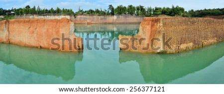 popular quarry pond for swimming and outdoor life, lake at excavation site in Opkhan national park near Chiang Mai, Thailand - stock photo
