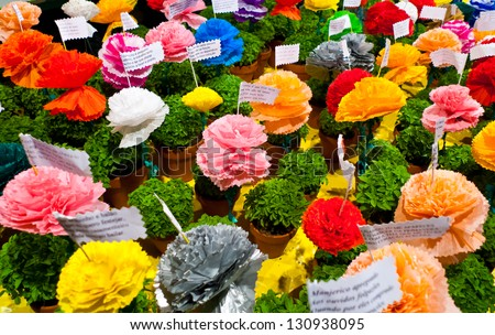 Popular saints festival in Lisbon, Portugal. Traditional Manjerico, little potted plants of newly sprouted Basil with paper-mache flowers are given as gifts during the month of June. - stock photo