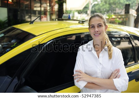 porait of a proud female taxi driver with her new cab
