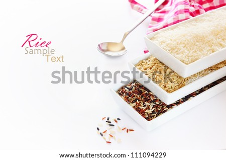 porcelain bowls of uncooked rice - stock photo