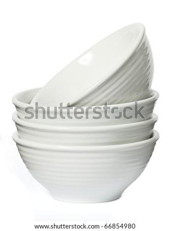 Porcelain bowls on a seamless white background - stock photo