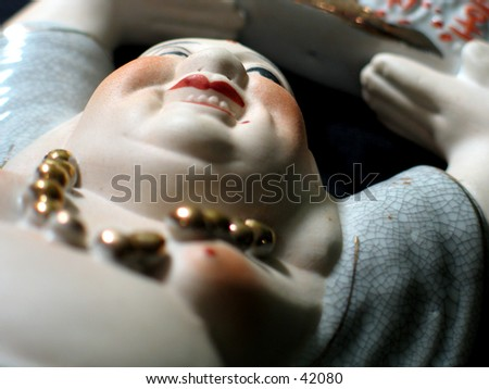 Porcelain Buddha - stock photo
