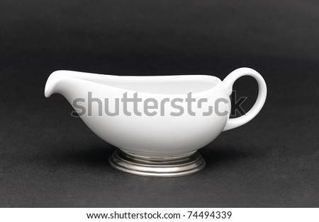 Porcelain cup for serving milk for tea or coffee time - stock photo