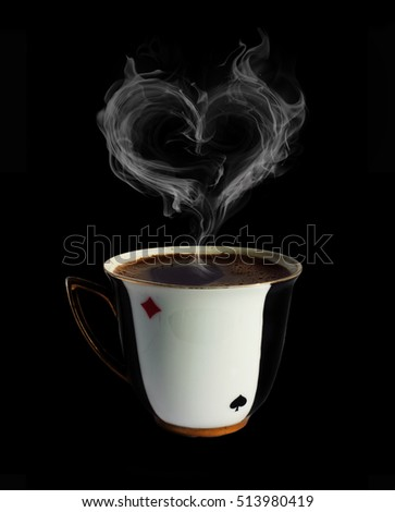 Porcelain cup of black coffee with heart shape smoke on black background