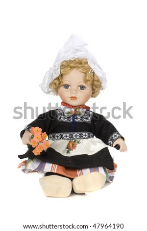 porcelain doll with traditional clothes - stock photo