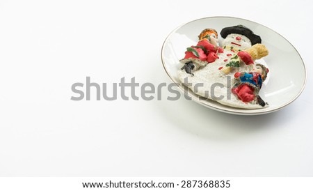 Porcelain figure of kids hugging snowman on dish plate. Concept of christmas and new year winter celebration. Slightly defocused and close up shot. Isolated on white background. Copy space. - stock photo