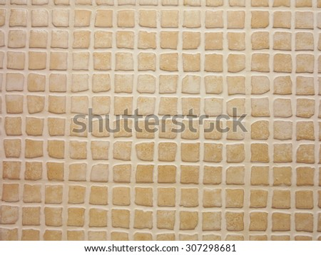 Porcelain pieces mosaic brown background tile pattern - stock photo