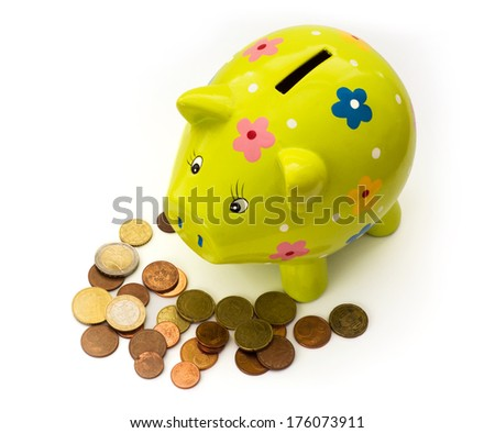 Porcelain piggy bank money box and coins on a white background. - stock photo