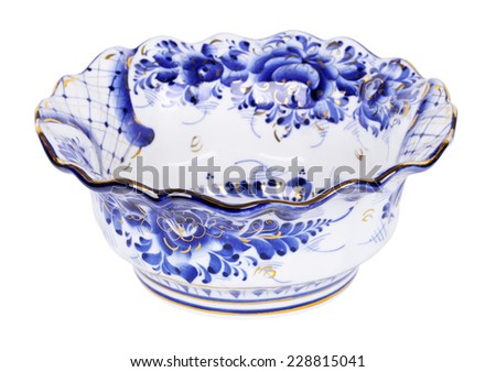 Porcelain salad bowl painted under Gzhel with the traditional pattern, isolated on white background - stock photo