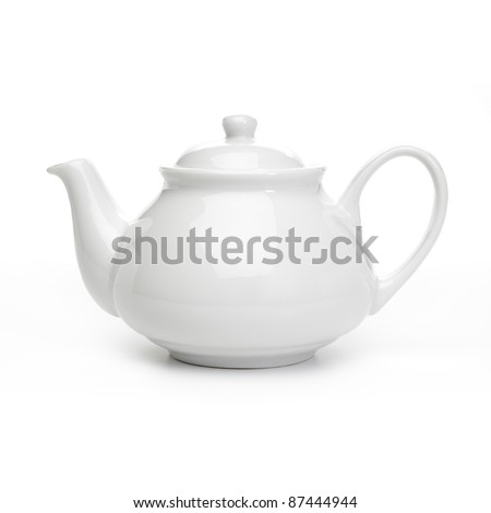 Porcelain teapot on white background - stock photo