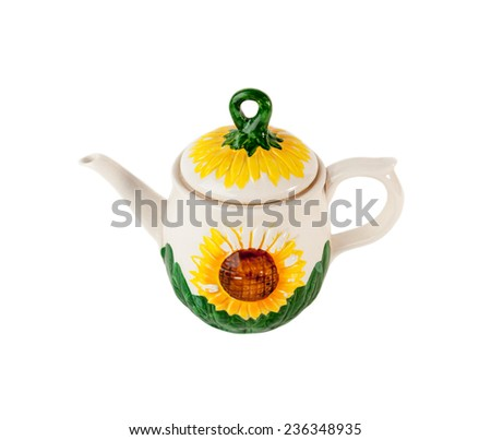 Porcelain teapot with sunflower ornament isolated over white - stock photo