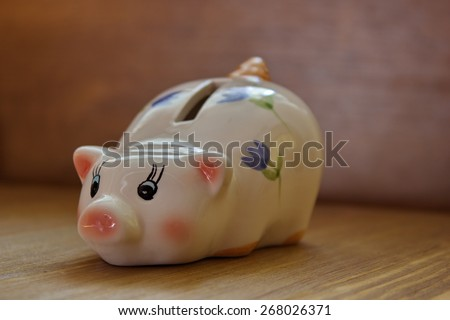 porcelaine painted money pig, piggy bank - stock photo