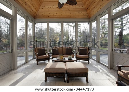 Porch in luxury home with wood ceiling