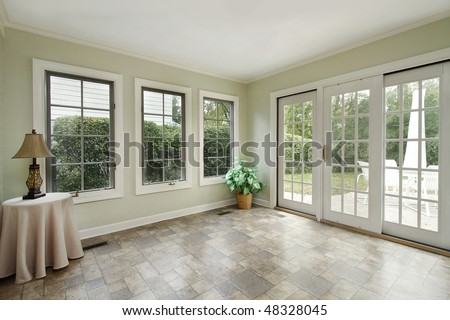 Porch in suburban home with door to patio