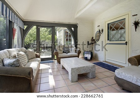 Porch in suburban home with wicker furniture - stock photo