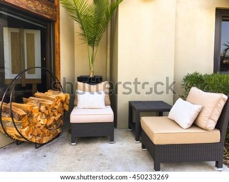 Porch sofa and wood fire outside backyard  - stock photo