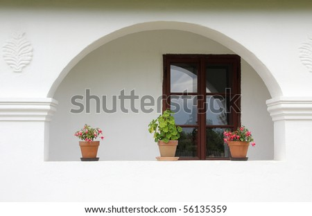 Porch windows and a country house with flowers. - stock photo