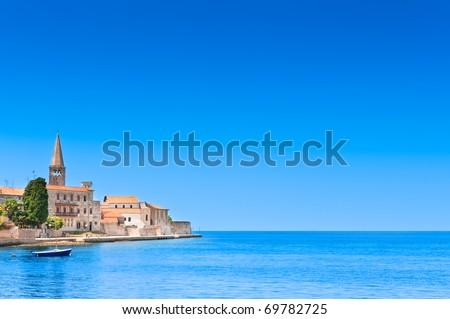 Porec old town in Croatia, Adriatic coast, Istria region, popular touristic destination. Copyspace on blue sky. - stock photo