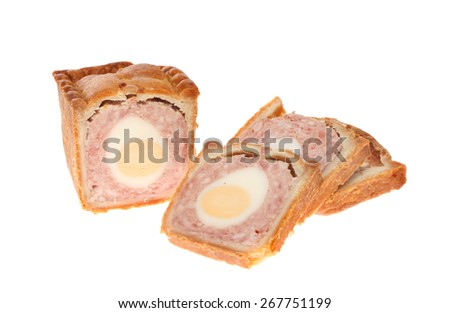 Pork and egg pie with cut slices isolated against white - stock photo