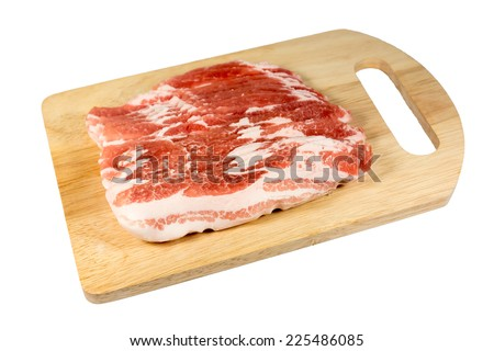 pork belly slice on a wooden board - stock photo