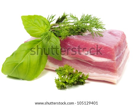 Pork belly with herbs spices on a white background - stock photo