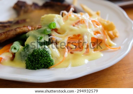 Pork Chop and vegetable salad - stock photo