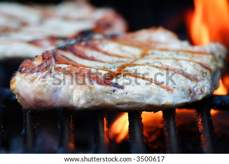Pork chop cooking on the grill