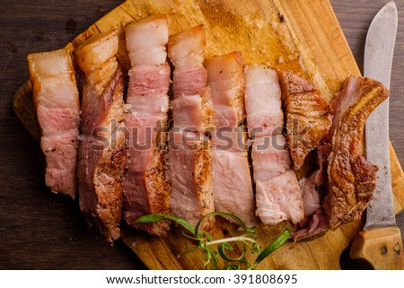 Pork Chop on chopping board ready to be eaten - stock photo