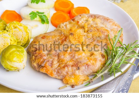 pork chop on white plate - stock photo