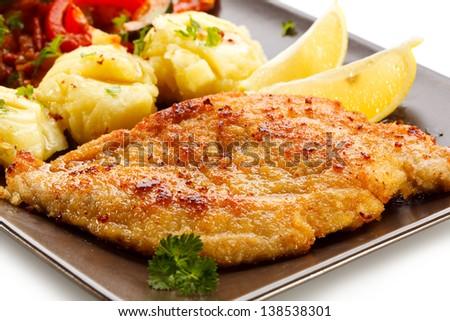 Pork chops, mashed potatoes and vegetable salad - stock photo