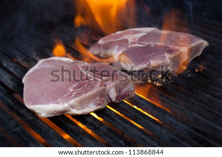 Pork Chops on Grill with Flames