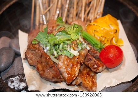 Pork chops served with wine lees sauce. - stock photo
