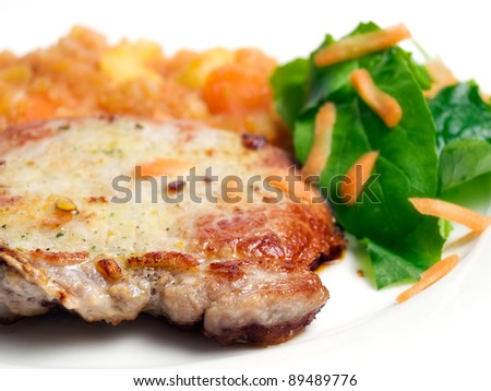 Pork chops with a savory side dish of vegetables
