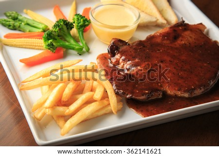 Pork chops with Black Thai Chili Sauce wooden background