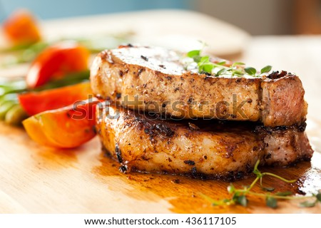 pork chops with vegetable - stock photo
