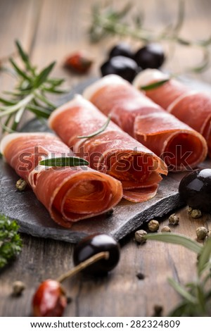 Pork collar ham on flagstone, rustic style - stock photo