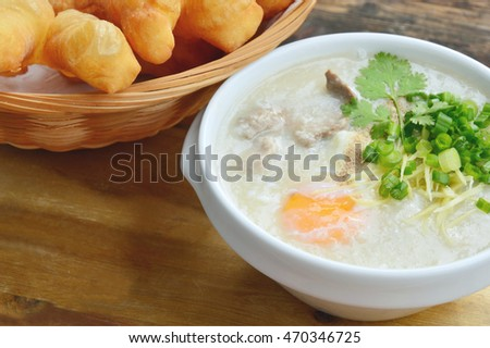 Pork congee with deep-fried dough stick. Rice porridge  with liver,minced pork,egg and deep - fried dough stick .