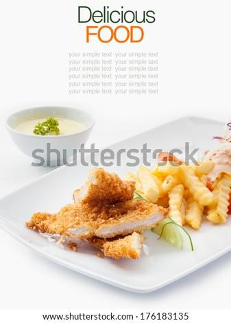 Pork cordon bleu with french fries. - stock photo