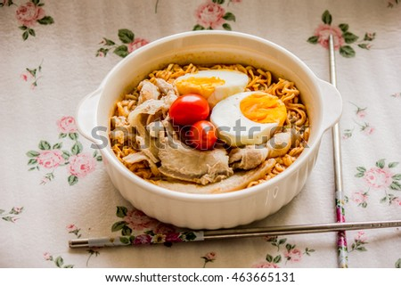 Pork, egg noodles flavored with tomatoes.