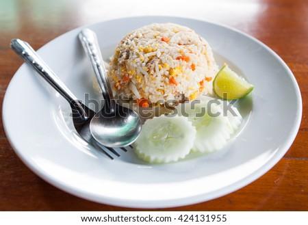 pork fried rice in white dish - stock photo